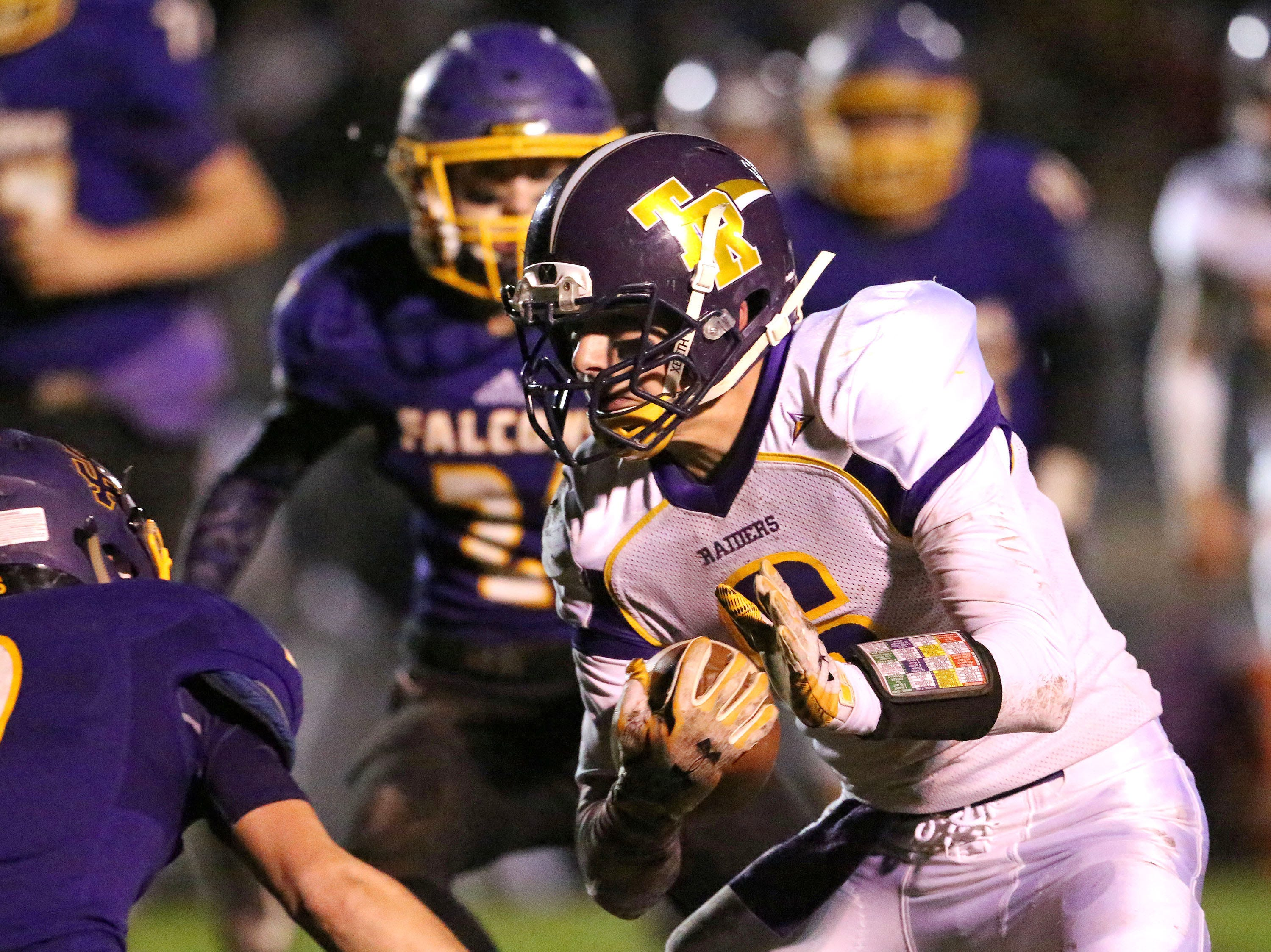 Two Rivers' Kyle Stewart (6) carries the ball against Sheboygan Falls, Friday, October 12, 2018, in Sheboygan Falls, Wis.