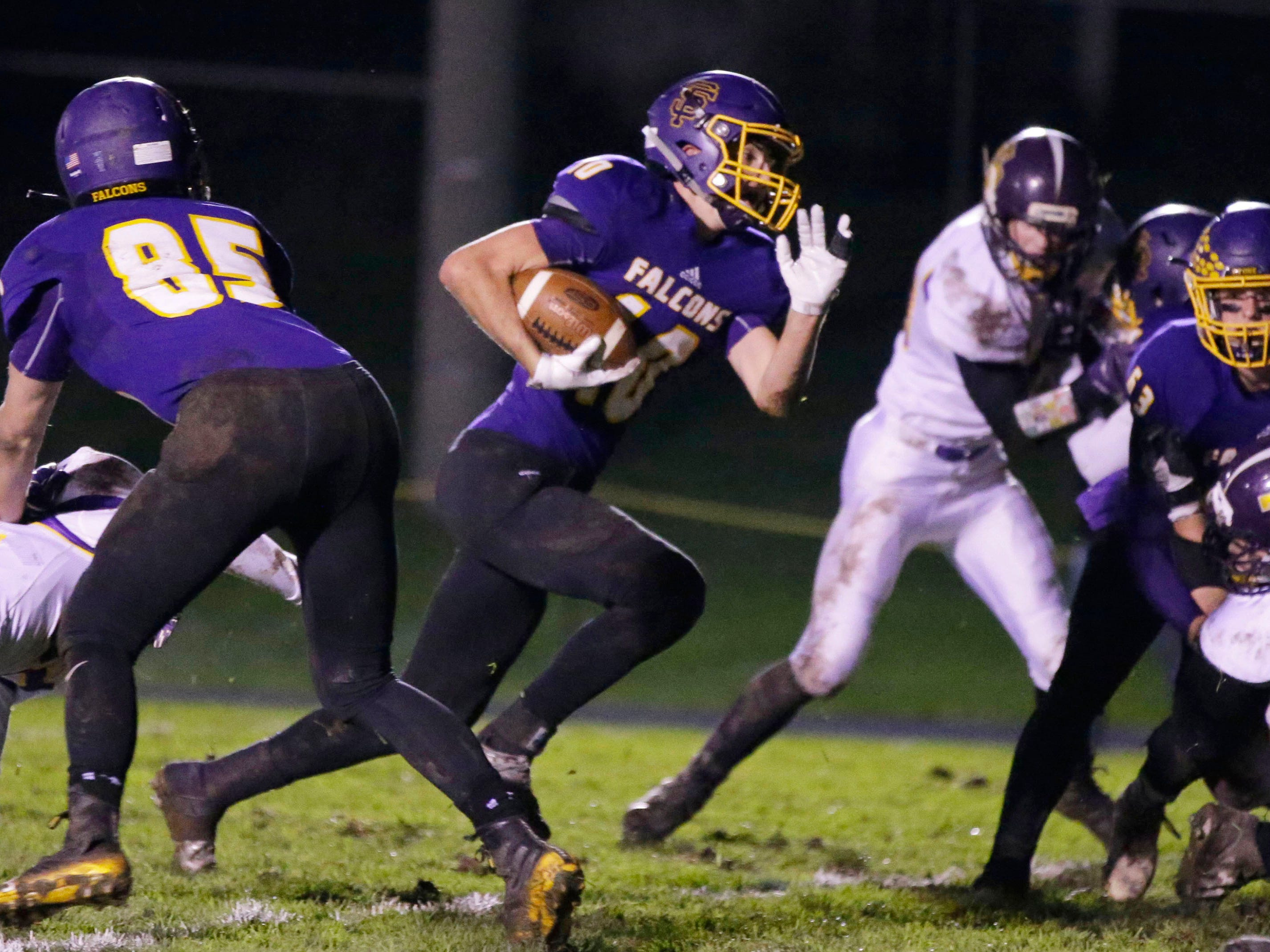 Sheboygan Falls' Justin Tenpas (10) carries the ball against Two Rivers, Friday, October 12, 2018, in Sheboygan Falls, Wis.