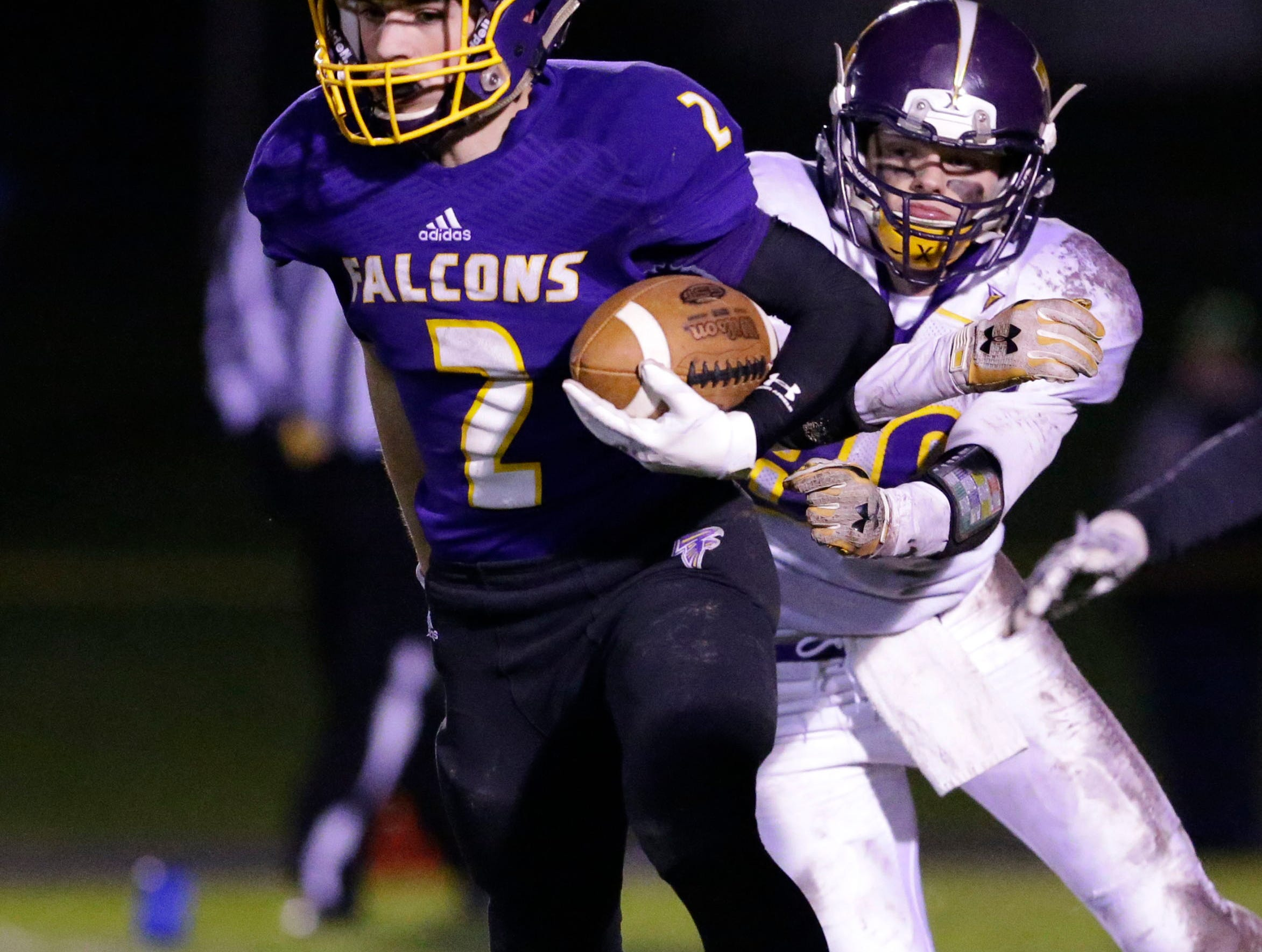Sheboygan Falls' Daniel Fenn (2) carries the ball against Two Rivers, Friday, October 12, 2018, in Sheboygan Falls, Wis.