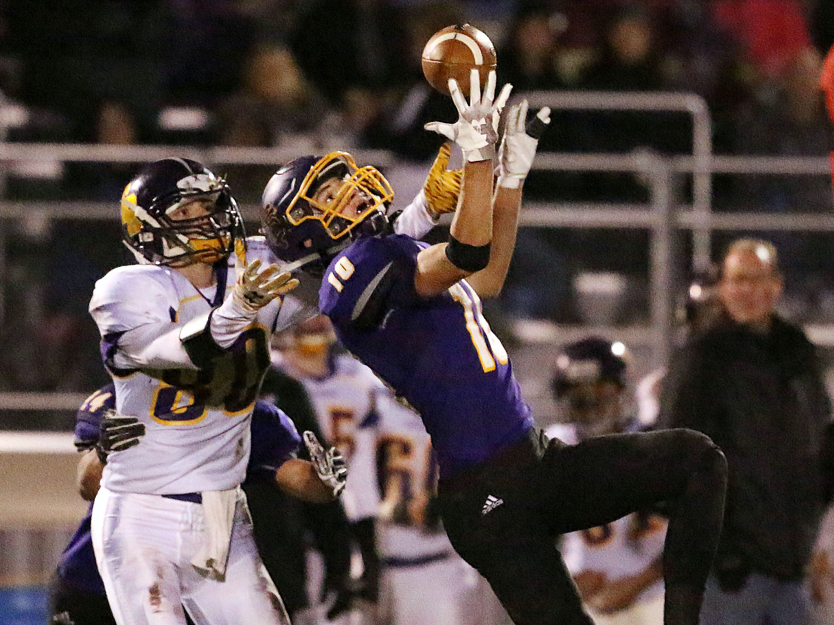 Sheboygan Falls' Justin Tenpas (10), intercepts the ball against Two Rivers' Austin Isley (80), Friday, October 12, 2018, in Sheboygan Falls, Wis.