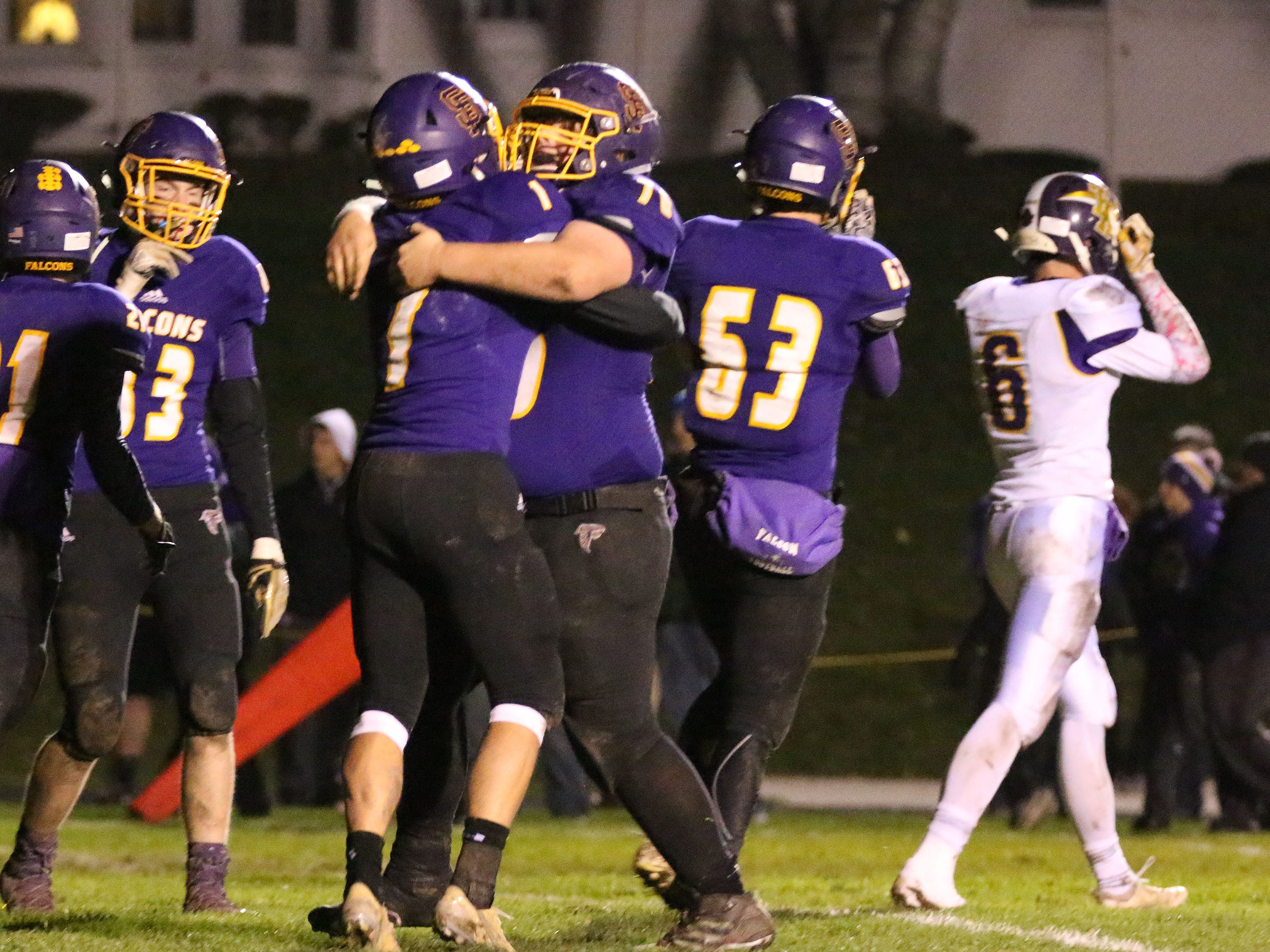 Sheboygan Falls players react to their 21-14 victory over Two Rivers, Friday, October 12, 2018, in Sheboygan Falls, Wis.