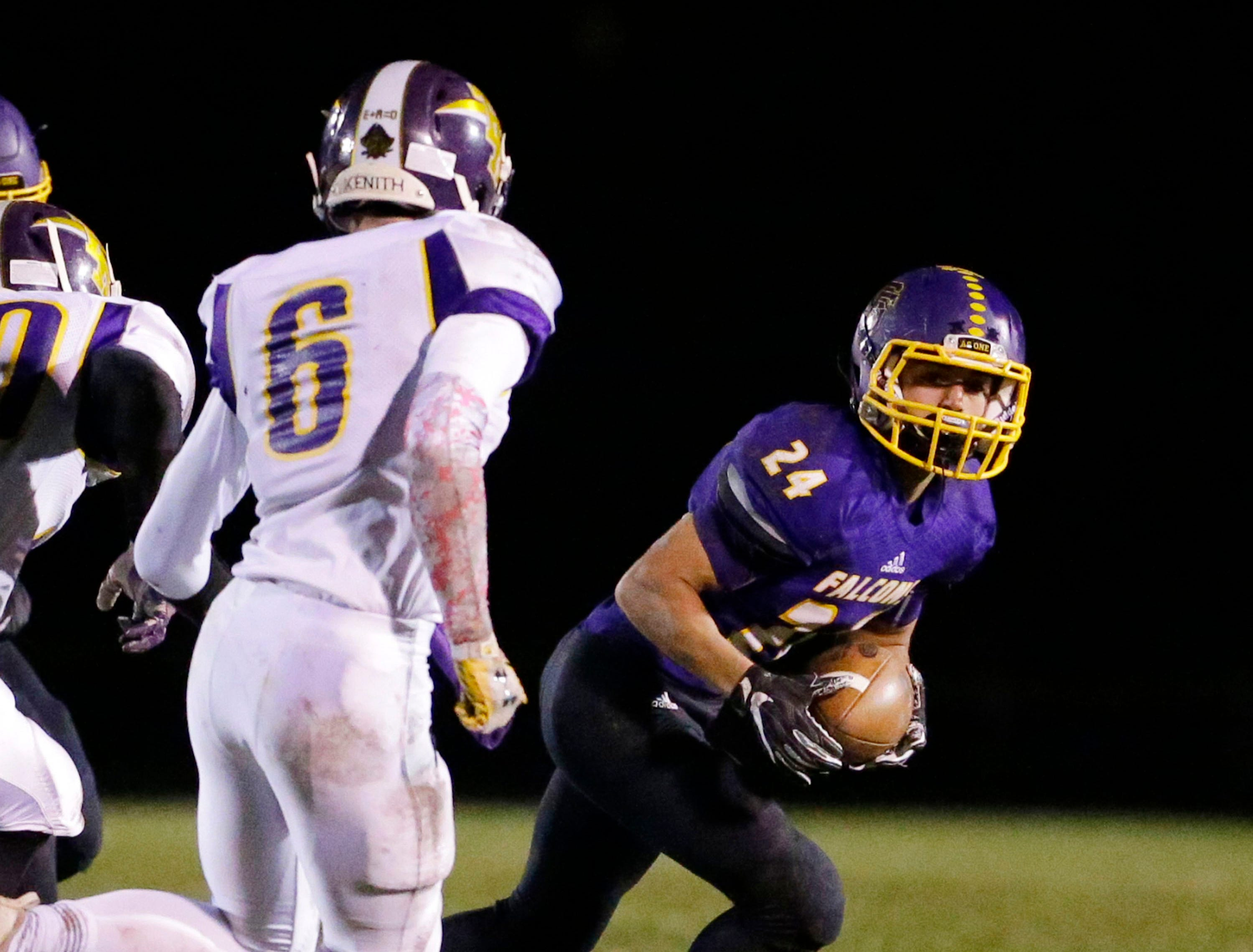 Sheboygan Falls' Mason Miller (24) carries the ball against Two Rivers, Friday, October 12, 2018, in Sheboygan Falls, Wis.