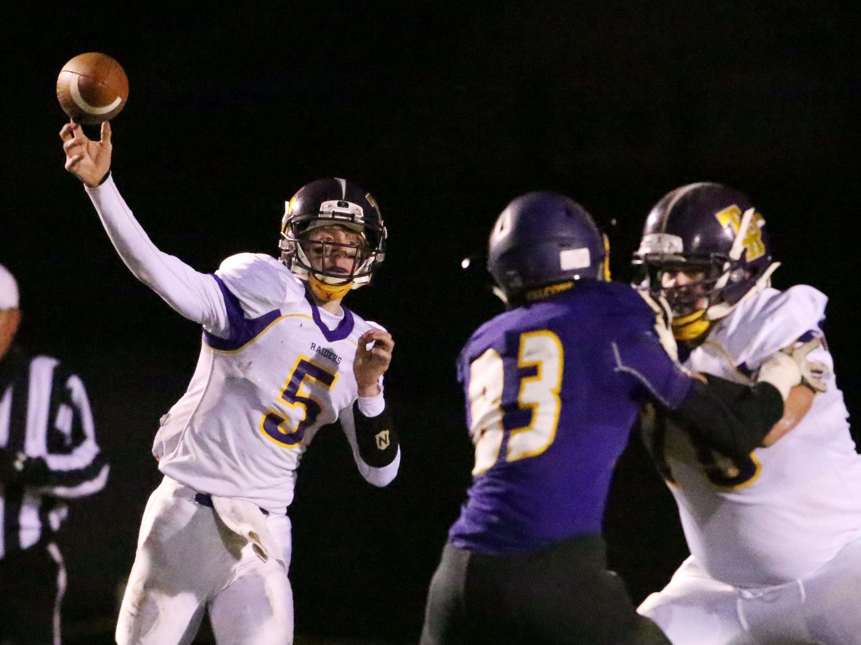 Two Rivers' Jayden Kiphart (5) passes the ball against Sheboygan Falls, Friday, October 12, 2018, in Sheboygan Falls, Wis.