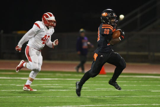 Washington's Tupak Kpeayeh runs the ball to break the all-time 11-man touchdown record against RC Central Friday, Oct. 12, at Howard Wood Field in Sioux Falls.