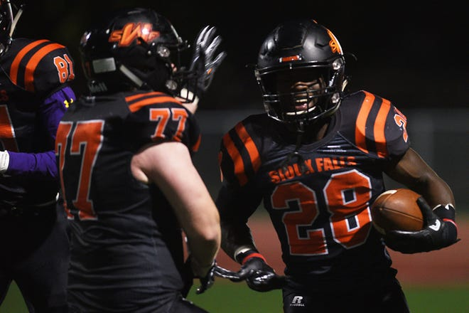 Washington's Tupak Kpeayeh celebrates after he breaks the all-time 11-man touchdown record against RC Central Friday, Oct. 12, at Howard Wood Field in Sioux Falls.