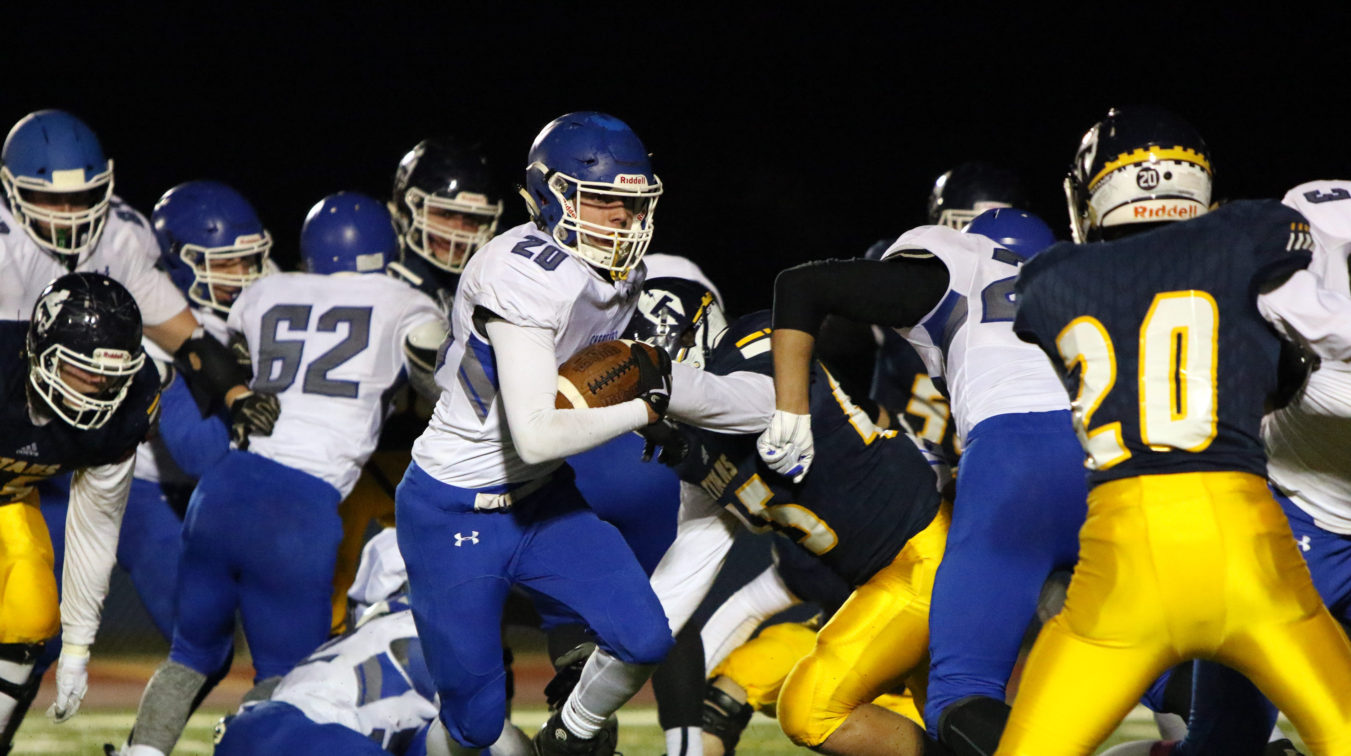 Parker Nelson of Sioux Falls Christian looks for running room past Wyatt VanTol of Tea Area during Friday night's game in Tea.