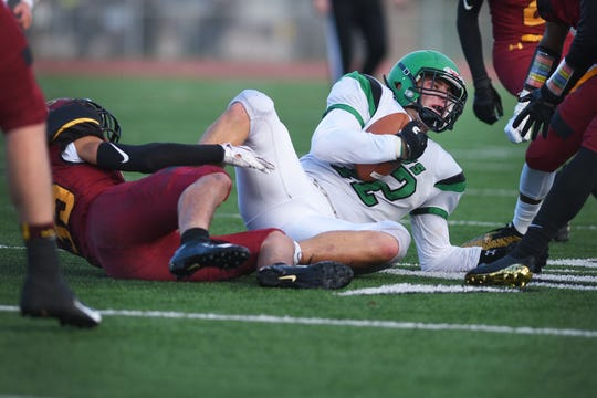 Pierre's Jack Maher holds onto the ball after he is talked during the game against Roosevelt Friday, Oct. 12, at Howard Wood Field in Sioux Falls.