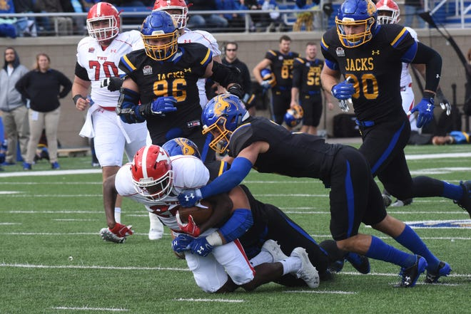 Youngstown State's Christian Turner (20) gets tackled during a game against South Dakota State Saturday, Oct. 13, 2018 in Brookings, S.D.