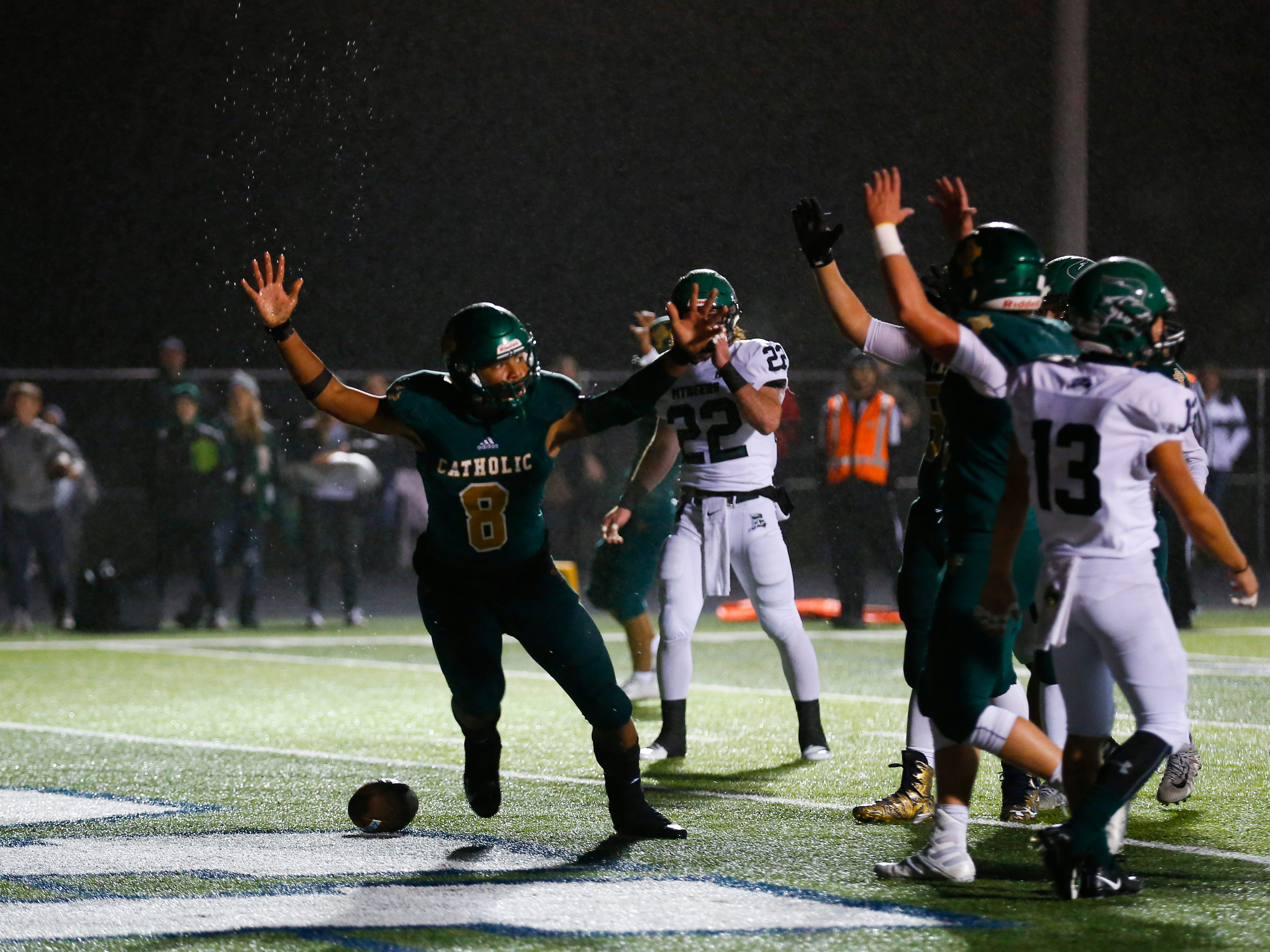 Springfield Catholics Tyson Riley celebrates after scoring a touchdown as the Fightin' Irish take on the Mt. Vernon Mountaineers at Catholic on Friday, Oct. 12, 2018.