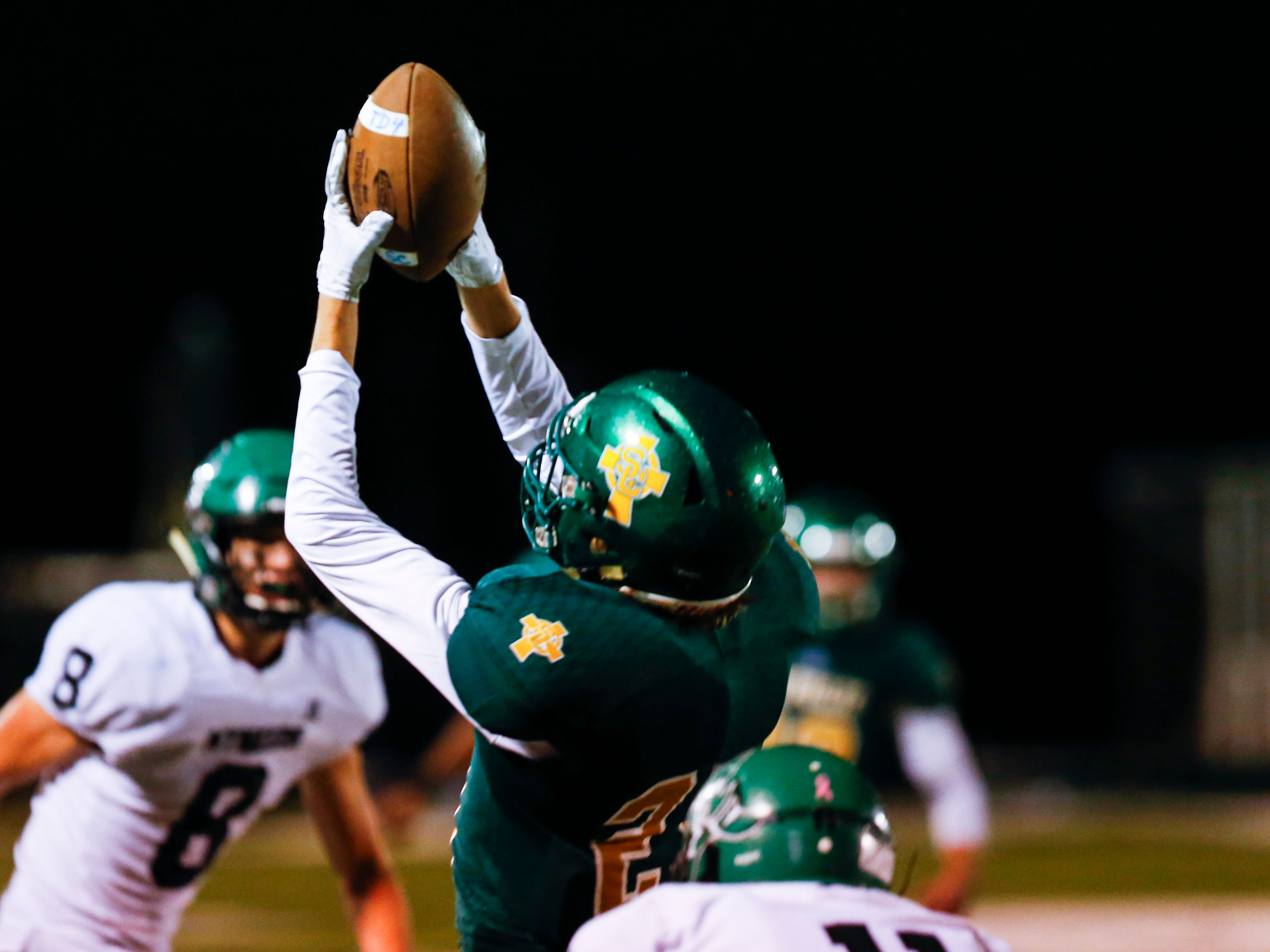 Springfield Catholics Charlie O'Reilly catches a pass during a game against the Mt. Vernon Mountaineers at Catholic on Friday, Oct. 12, 2018.