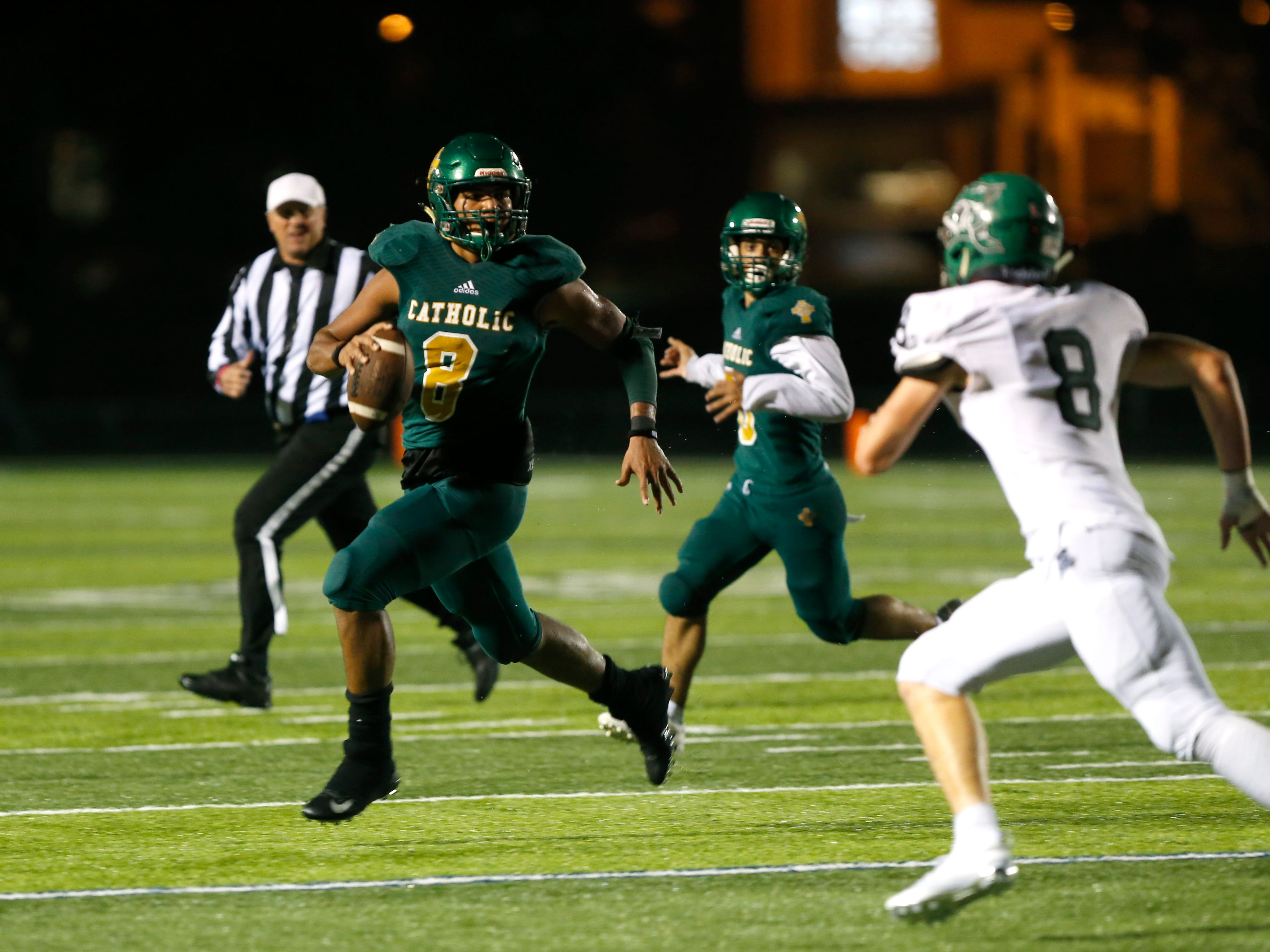 Springfield Catholics Tyson Riley runs with the ball as the Fightin' Irish take on the Mt. Vernon Mountaineers at Catholic on Friday, Oct. 12, 2018.