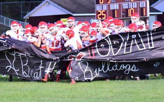 Riverheads' football team breaks through the cheerleaders' banner as it takes the field for its Shenandoah District football game against Luray on Friday, Oct. 12, 2018, at Bulldog Field in Luray, Va.