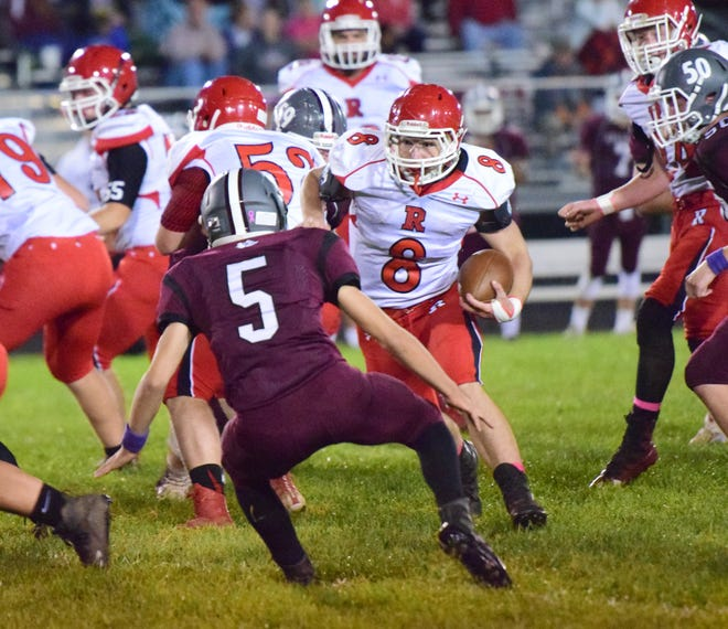 Riverheads' Zac Smiley looks for running room around Luray's Jaden Couper during the first quarter of their Shenandoah District football game on Friday, Oct., 12 ,2018, at Bulldog Field in Luray, Va.