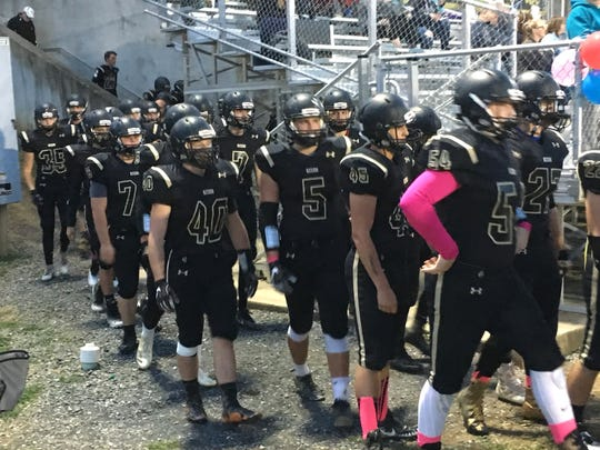 Buffalo Gap players walk to the field Friday night as they prepare to play East Rockingham.