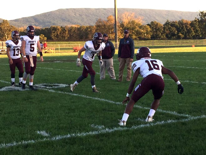 Stuarts Draft warms up before its game at Stonewall Jackson Friday night.