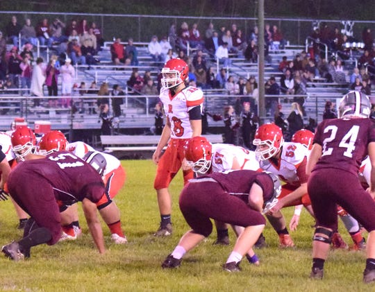 Riverheads quarterback Justin McWhorter approaches the line of scrimmage during the first quarter of the Gladiators' Shenandoah District football game against Luray on Friday, Oct. 12, 2018, at Bulldog Field in Luray, Va.