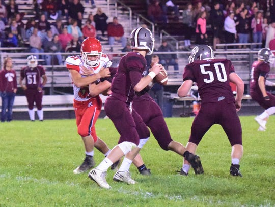 Riverheads defensaive lineman Ethan Hartless, left, tries to get to Luray quarterback Dalton Griffith during the first quarter of their Shenandoah District football game on Friday, Oct. 12, 2018, at Bulldog Field in Luray, Va.