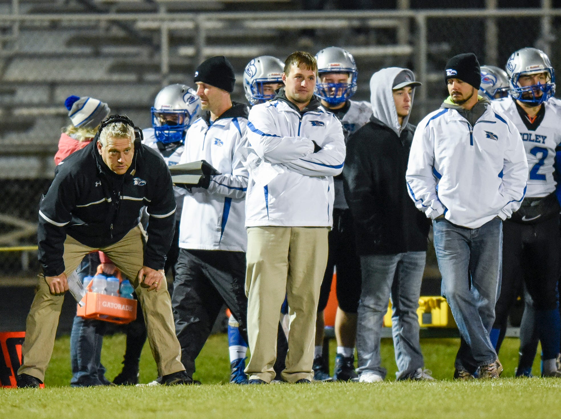 Foley coaches and players watch the action along the sidelines during the first half Friday, Oct. 12, in Albany.
