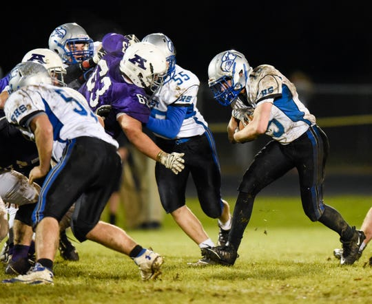 Foley running back Mark Dierkes runs for a gain against Albany during the first half Friday, Oct. 12, in Albany.