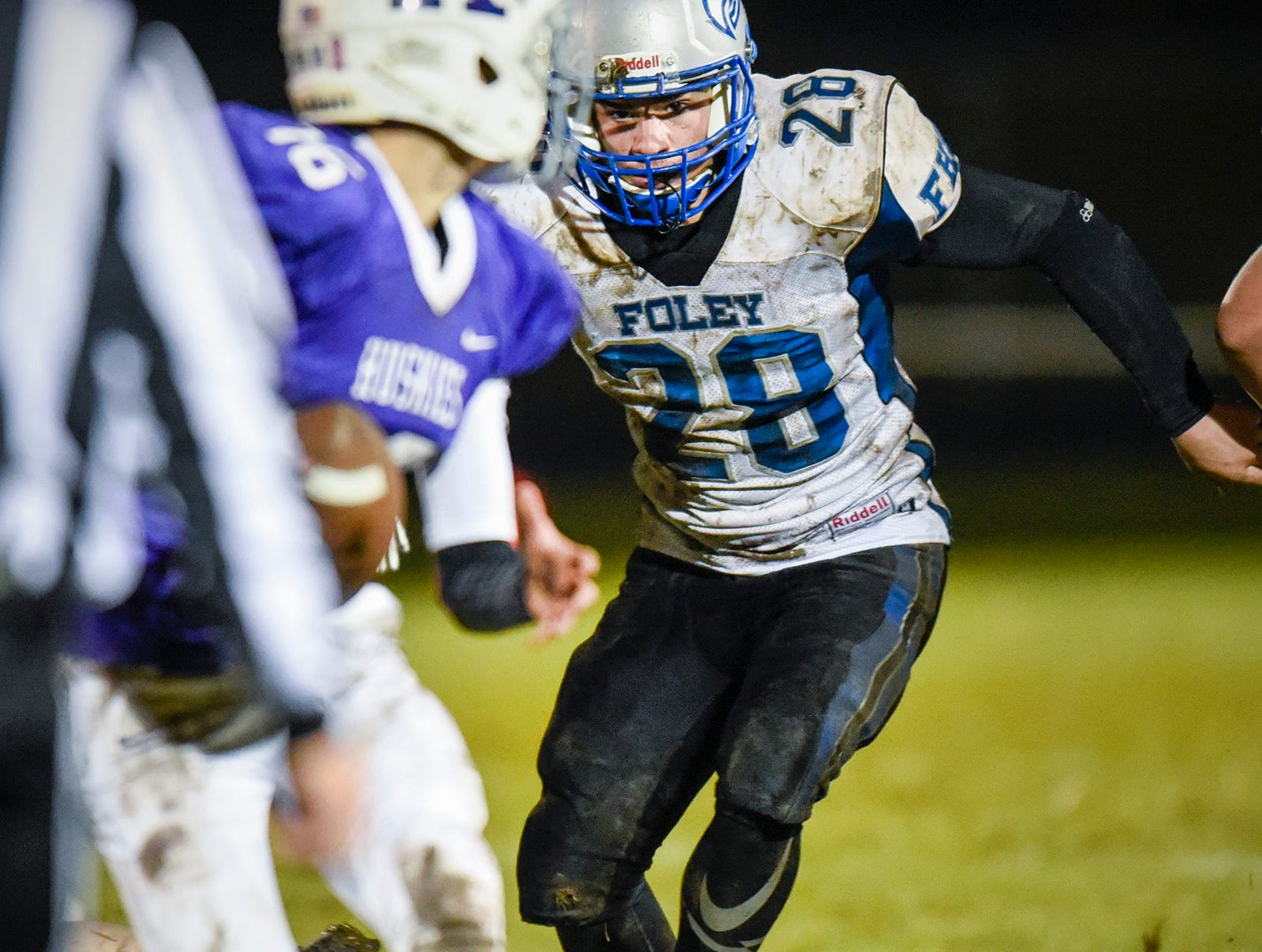 Foley's Max Lefebvre aims for Albany's quarterback during the first half Friday, Oct. 12, in Albany.