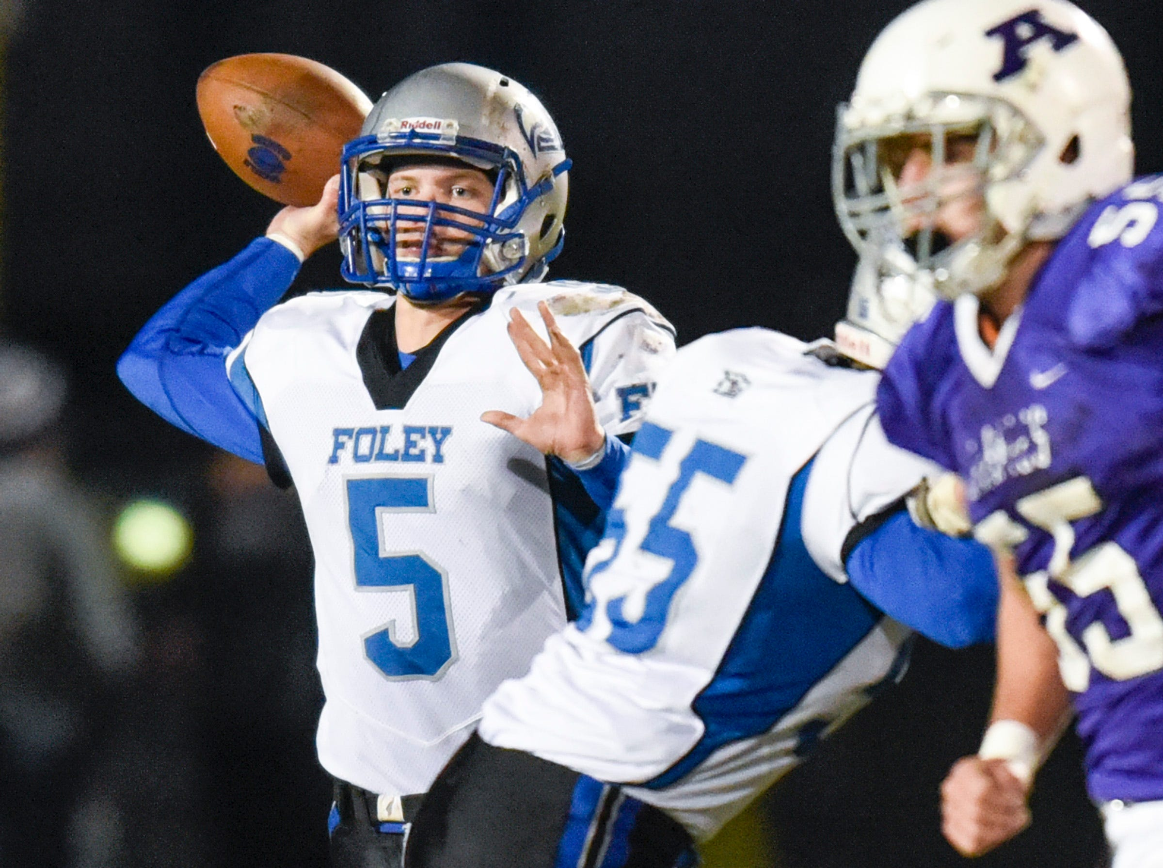 Foley quarterback Alex Foss throws a pass against Albany during the first half Friday, Oct. 12, in Albany.