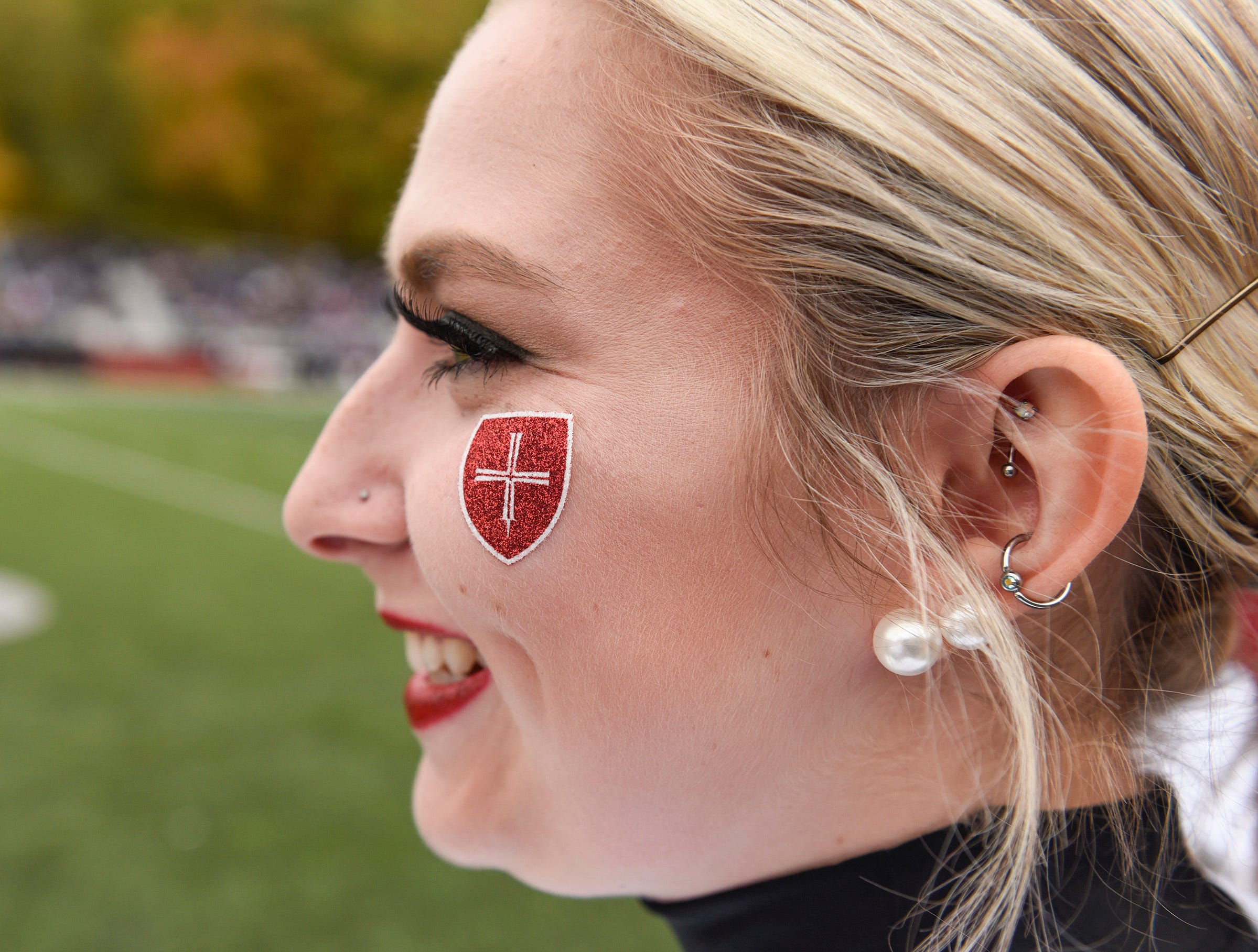 A College of St. Benedict dance team member watches for the St. John's football team to come on the field Saturday, Oct. 13, in Collegeville.