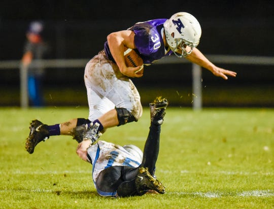 Albany's Gabe Zierden is brought down by Foley's Mark Dierkes on a run during the first half Friday, Oct. 12, in Albany.