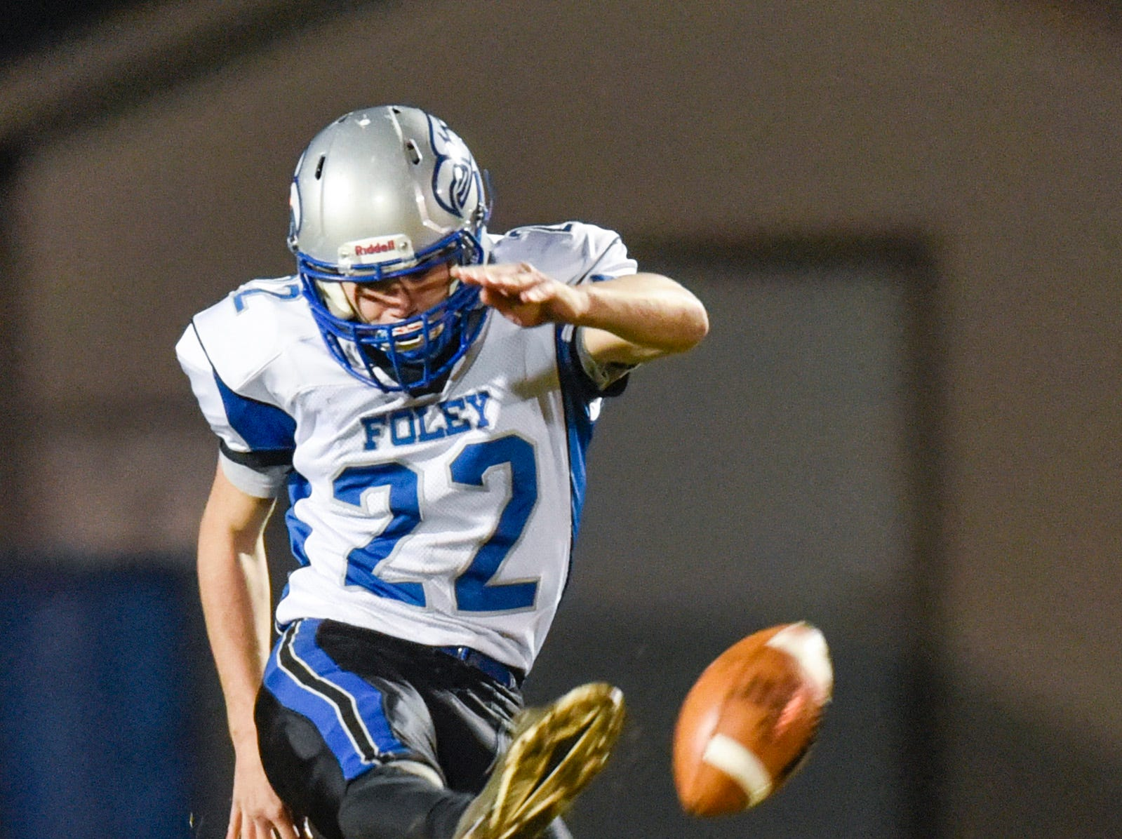 Foley's Brady Wirth punts to Albany during the first half Friday, Oct. 12, in Albany.