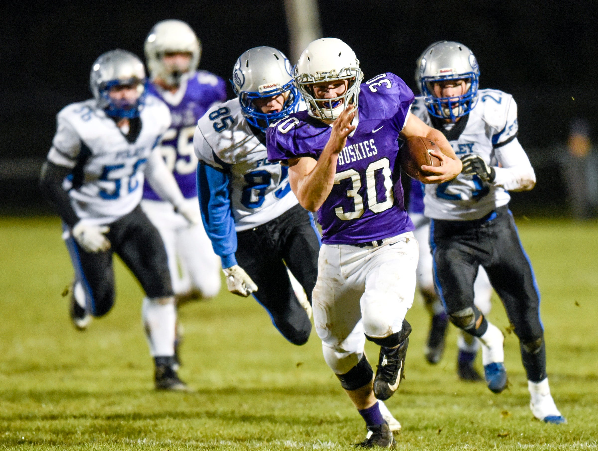 Albany's Gabe Zierden runs for a first down against Foley during the first half Friday, Oct. 12, in Albany.