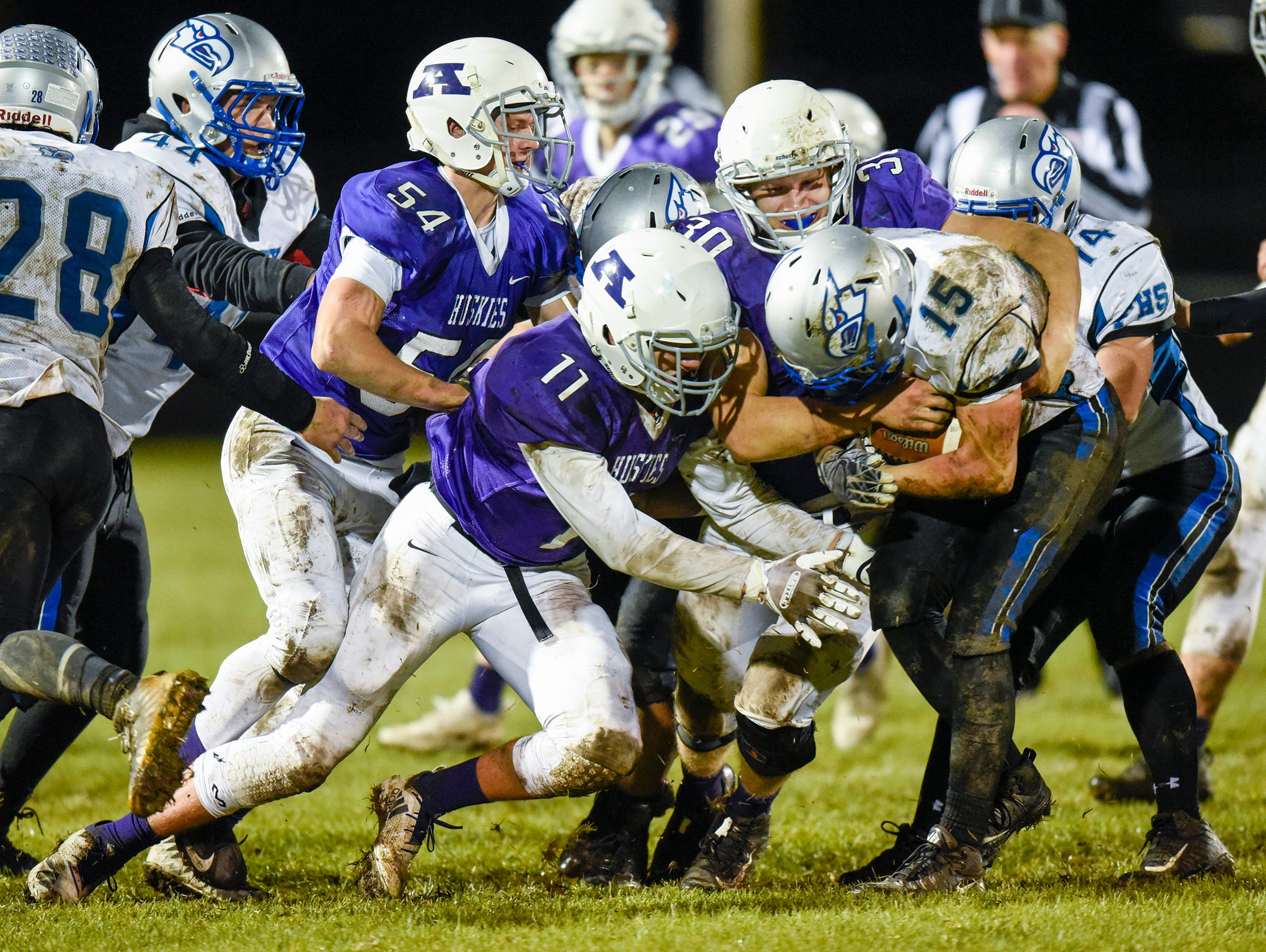 Albany's defense stops Foley's Mark Dierkes during the first half Friday, Oct. 12, in Albany.