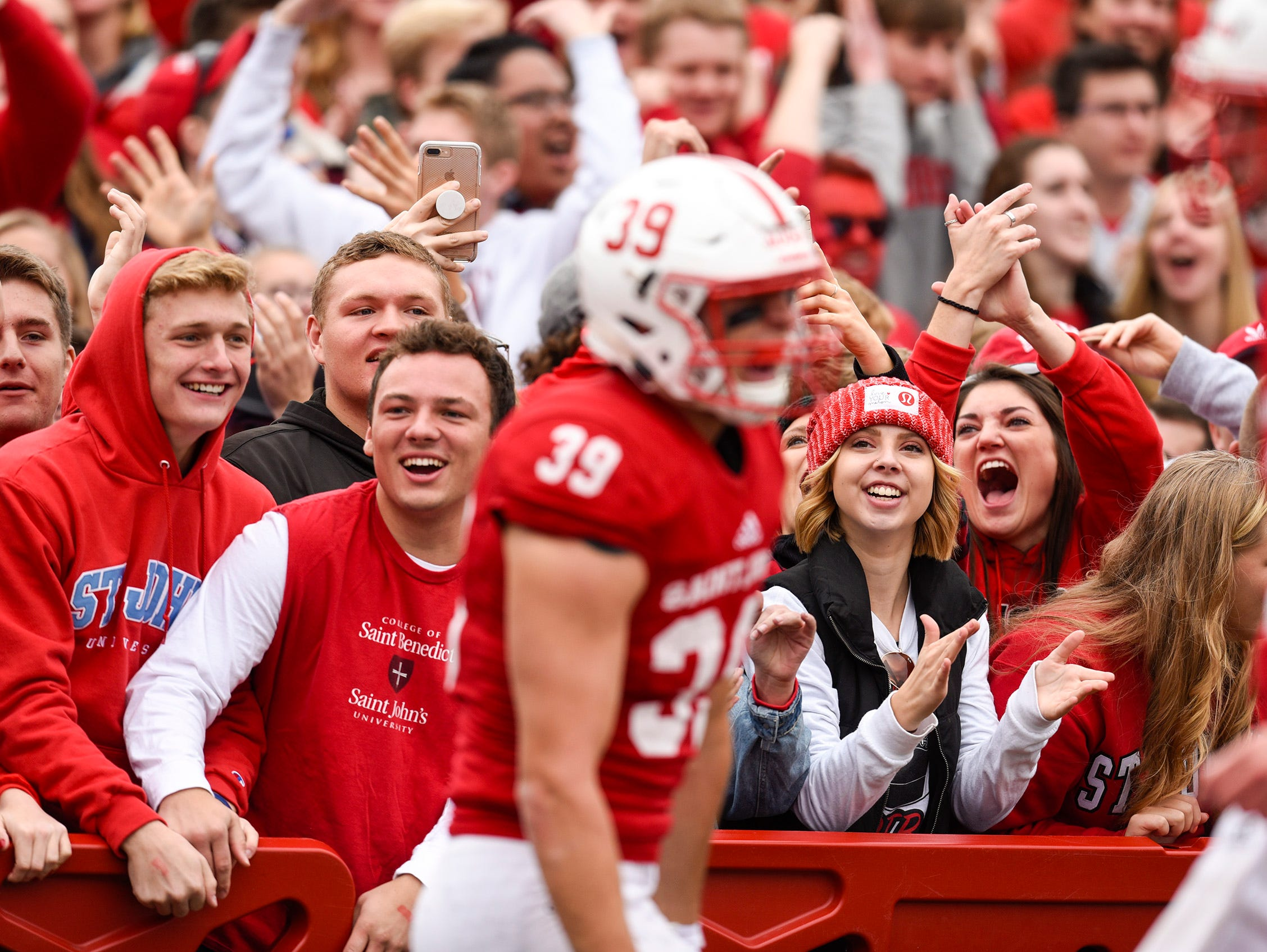 St. John's fans celebrate a touchdown against St. Thomas during the first half Saturday, Oct. 13, in Collegeville.