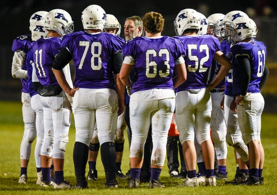 Albany's head coach Mike Kleinschmidt talks with players during a time out against  Foley's during the first half Friday, Oct. 12, in Albany.