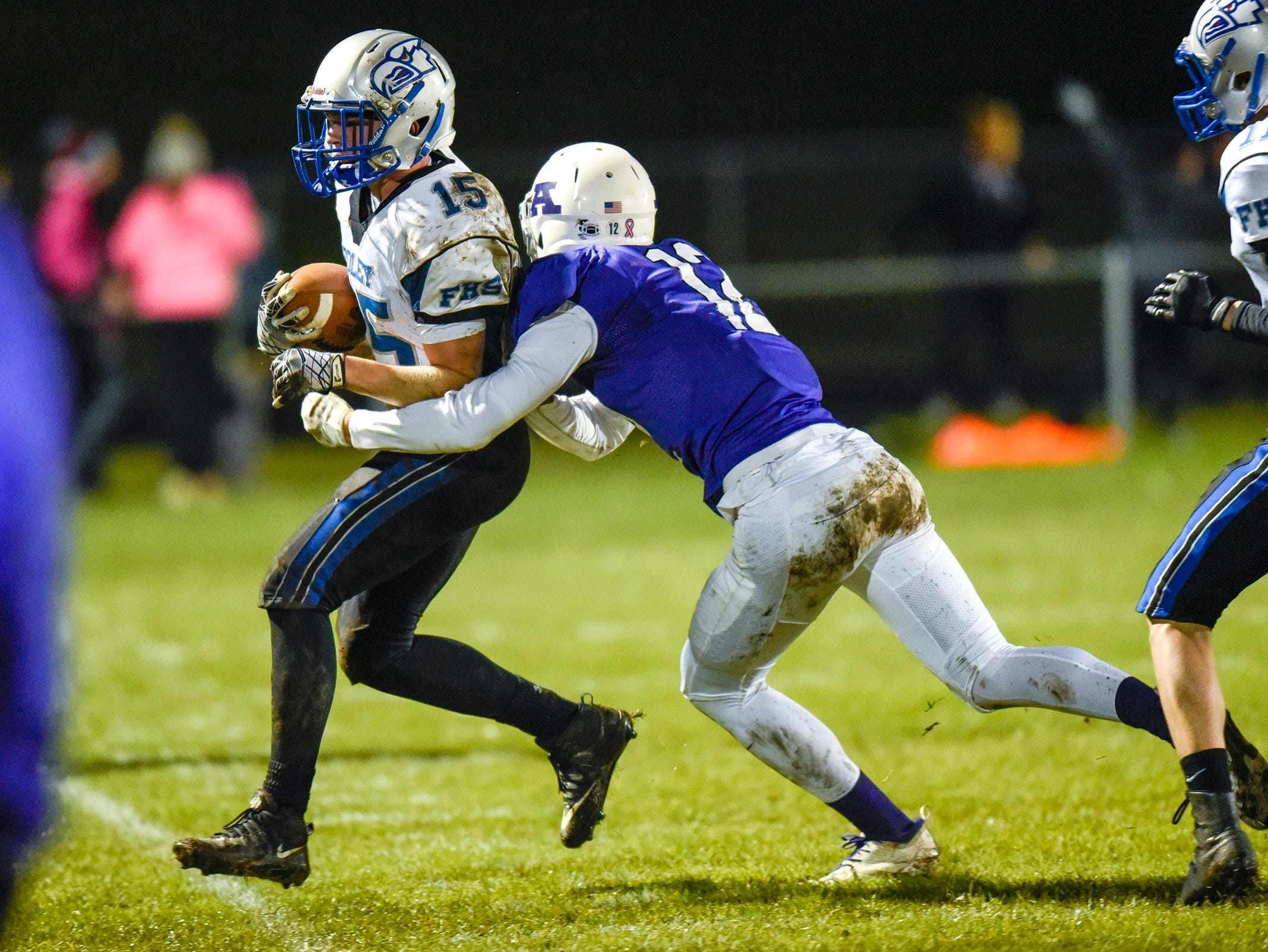 Foley running back Mark Dierkes is tackled by Albany's Ben Buttweiler during the first half Friday, Oct. 12, in Albany.