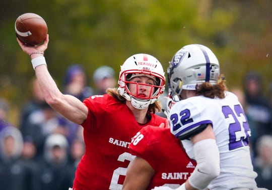St. John's quarterback Jackson Erdmann throws a pass against St. Thomas' during the first half Saturday, Oct. 13, in Collegeville.