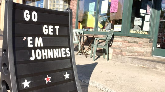 A sign outside of The Local Blend in St. Joseph shows support ahead of the Johnnies/Tommies football game Saturday, Oct. 13.