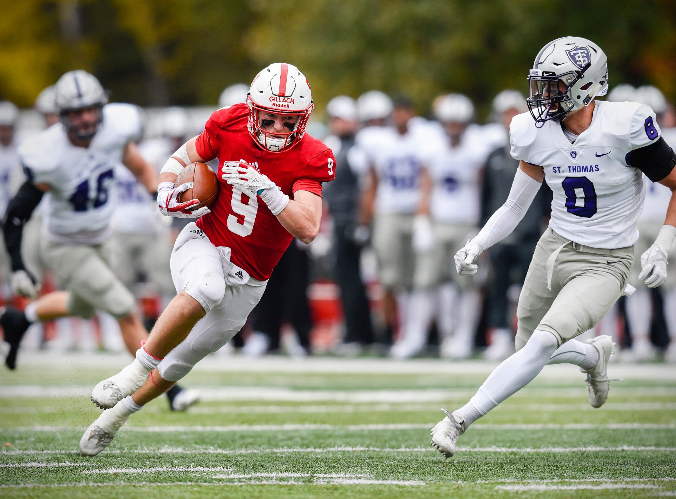 St. John's wide receiver Will Gillach gains yardage against the St. Thomas defense  during the first half Saturday, Oct. 13, in Collegeville.