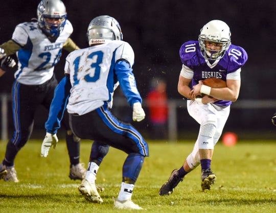 Albany's Carter Kotzer finds room to run against Foley during the first half Friday, Oct. 12, in Albany.