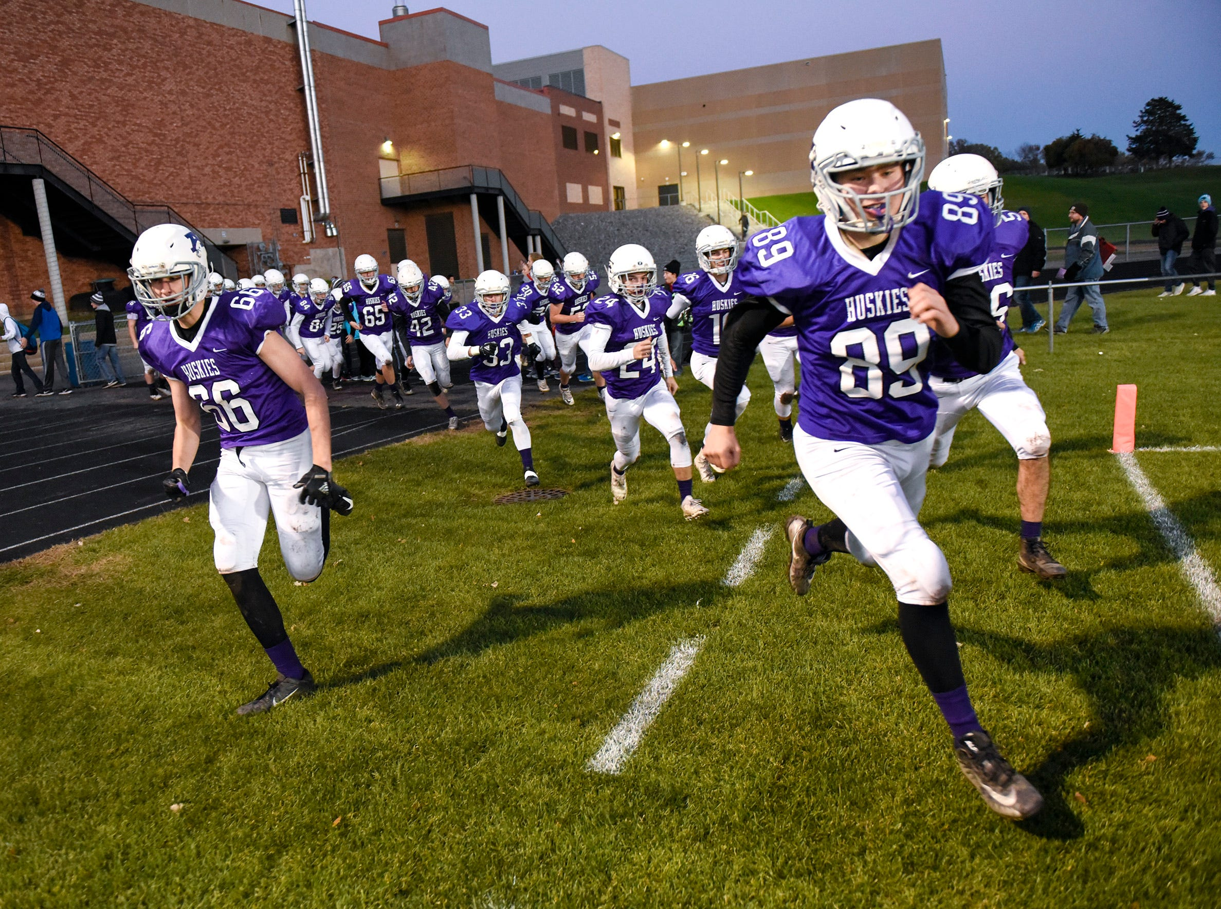 Albany players come on the field before their game against Foley Friday, Oct. 12, in Albany.