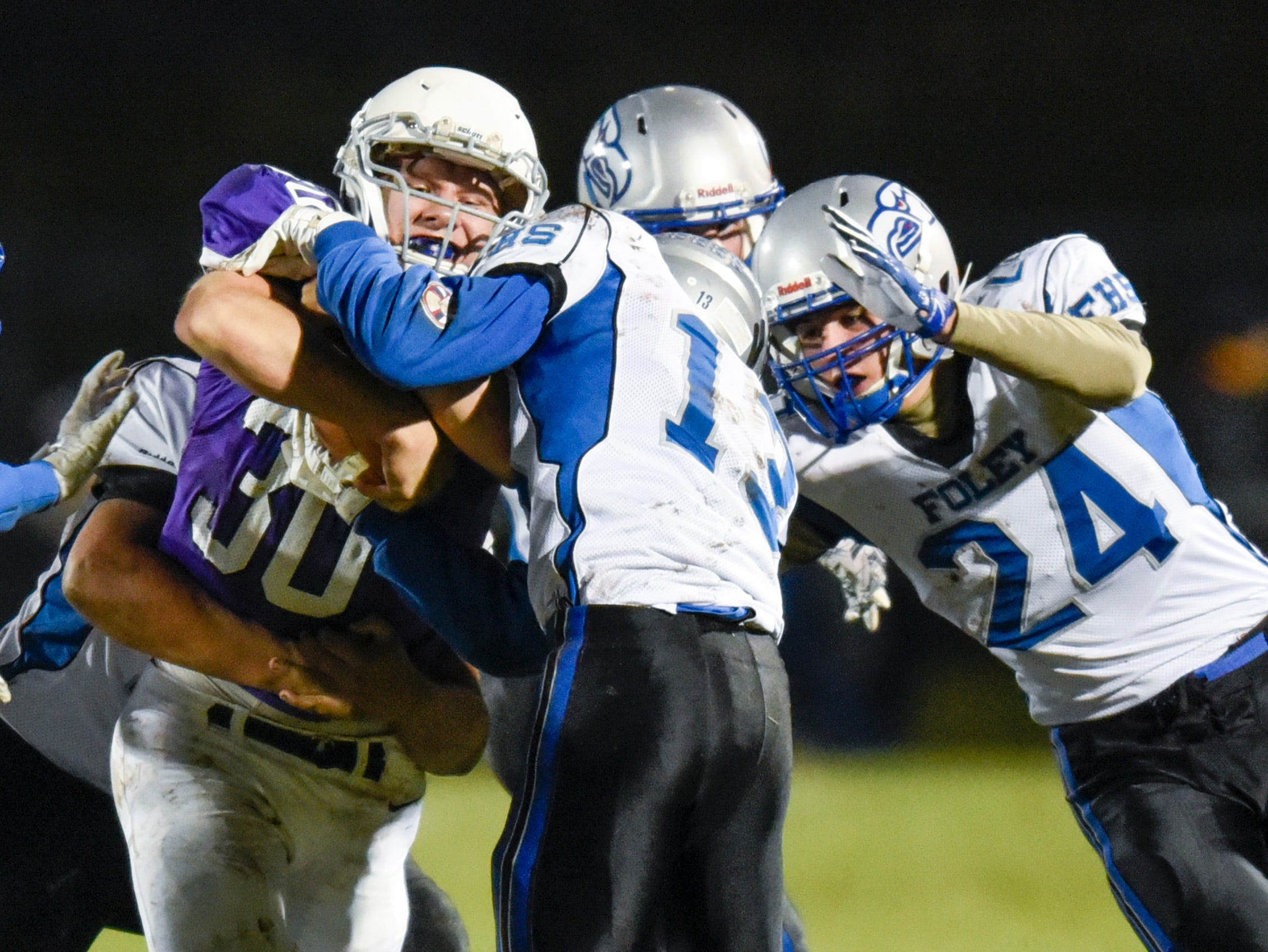 Albany's Gabe Zierden is brought down by the Foley defense during the first half Friday, Oct. 12, in Albany.