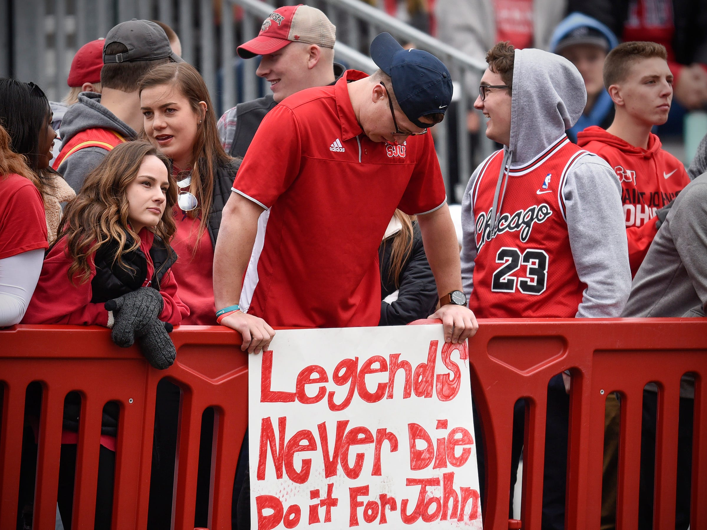 Students in the St. John's student section remember John Gagliardi Saturday, Oct. 13, in Collegeville.