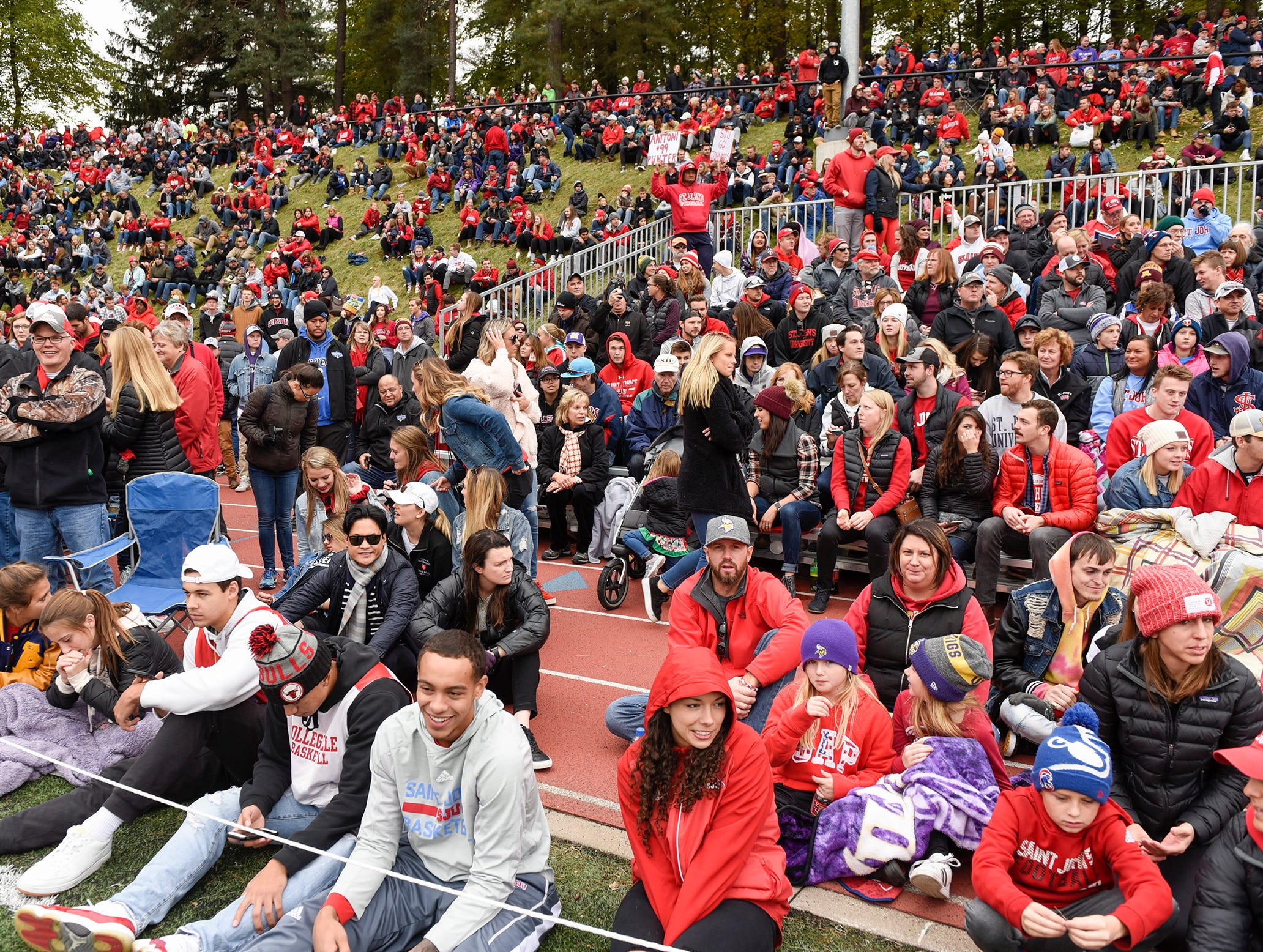 Fans find a place to watch the St. John's and St. Thomas football Saturday, Oct. 13, in Collegeville.