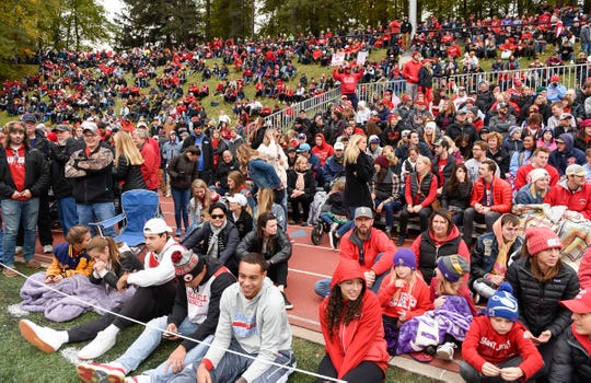 Fans find a place to watch the St. John's and St. Thomas football Oct. 2018, in Collegeville.
