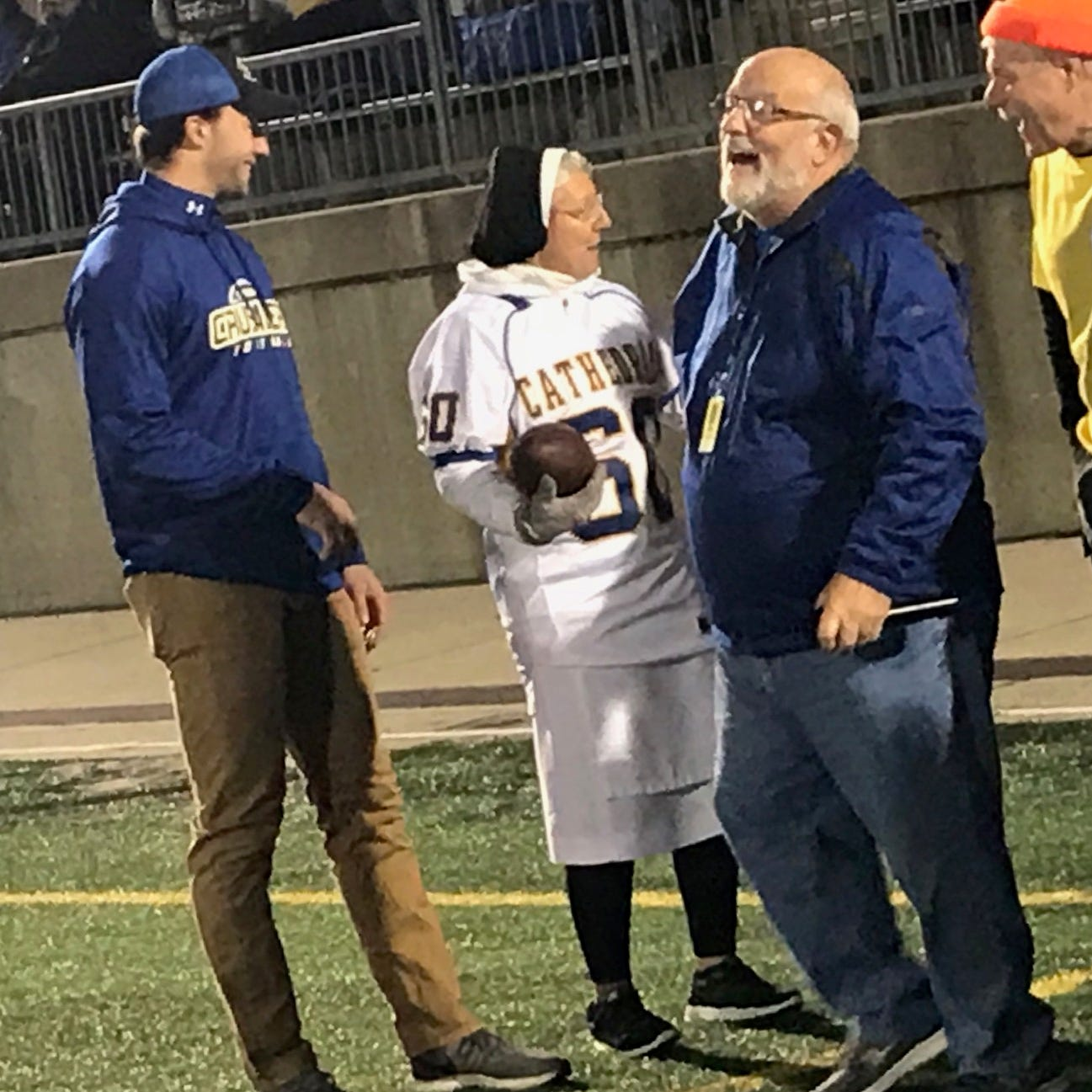 Sister Mary Jo Sobieck calls audible, throws 1st pass before Cathedral homecoming game