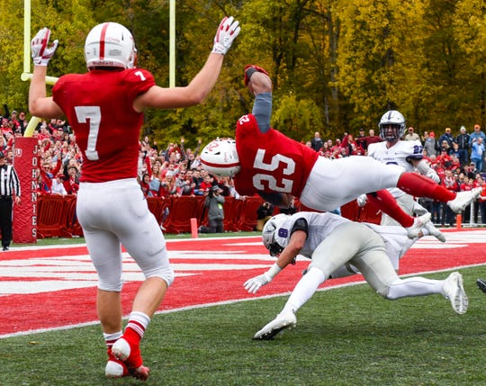 St. John's running back Kai Barber flips into the end zone to score against St. Thomas during the first half of the 2018 game in Collegeville.