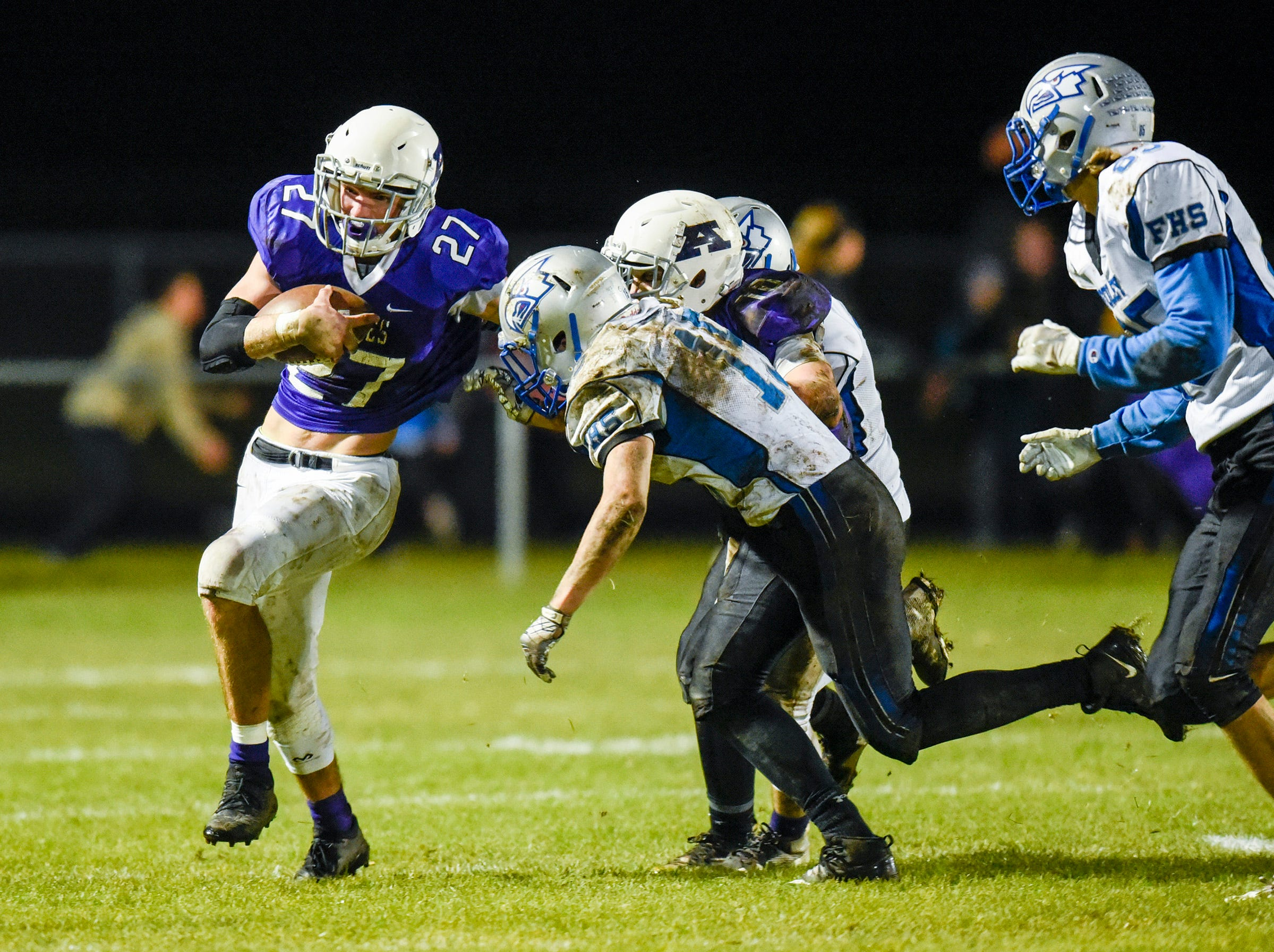 Albany running back Nolan Rueter breaks around the Foley defense during the first half Friday, Oct. 12, in Albany.