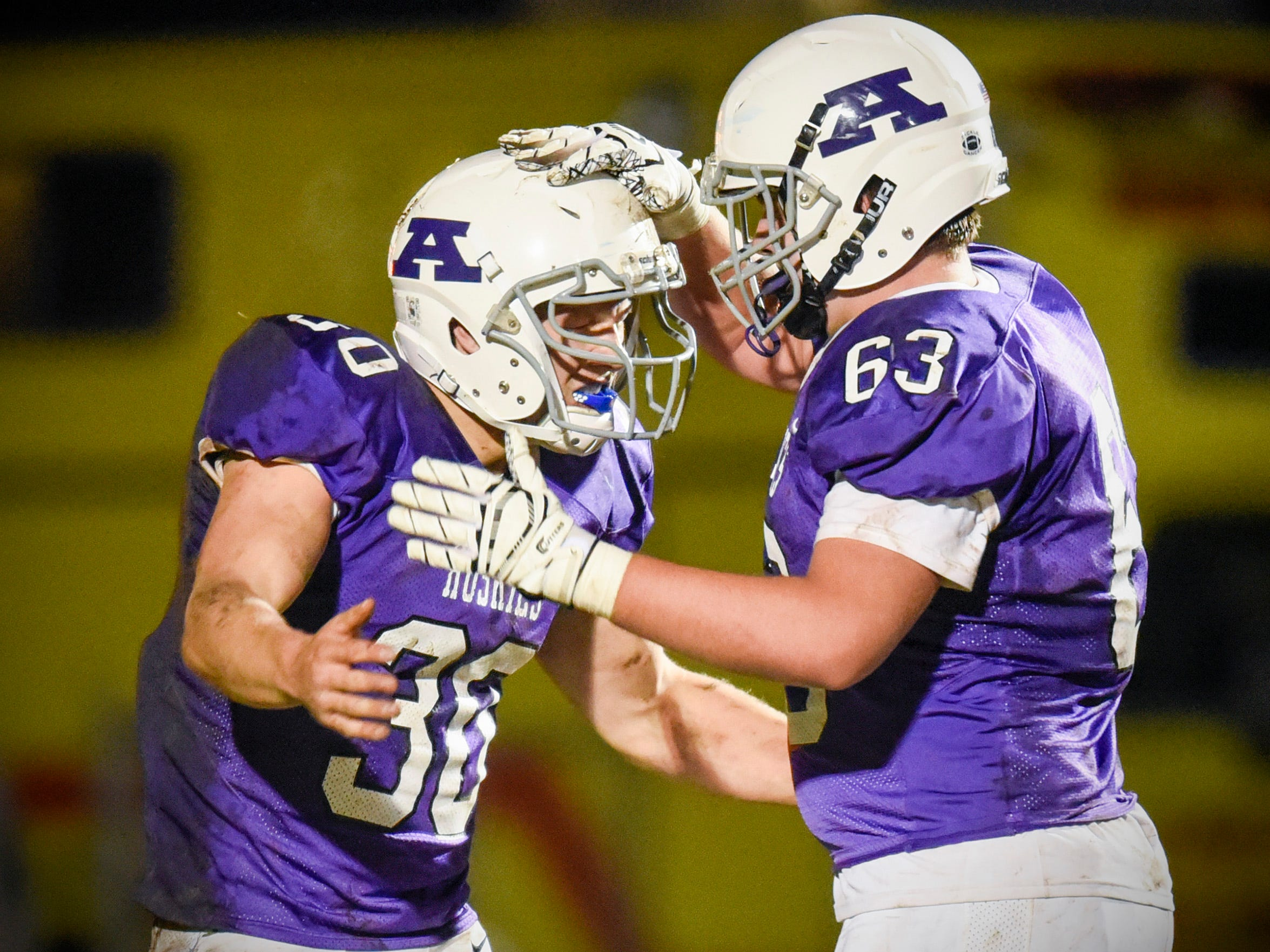 Albany's Gabe Zierden celebrates his touchdown with teammate Devin Ritter against Foley during the first half Friday, Oct. 12, in Albany.