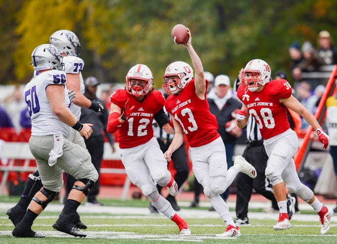 St. John's defensive corner Sam Westby, 13, celebrates his interception against St. Thomas during the first half Saturday, Oct. 13, in Collegeville.