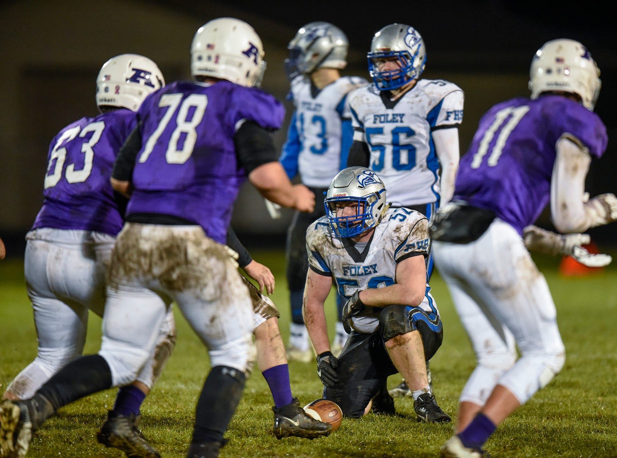 Foley's defense watches Albany's formation as they come to the line during the first half Friday, Oct. 12, in Albany.