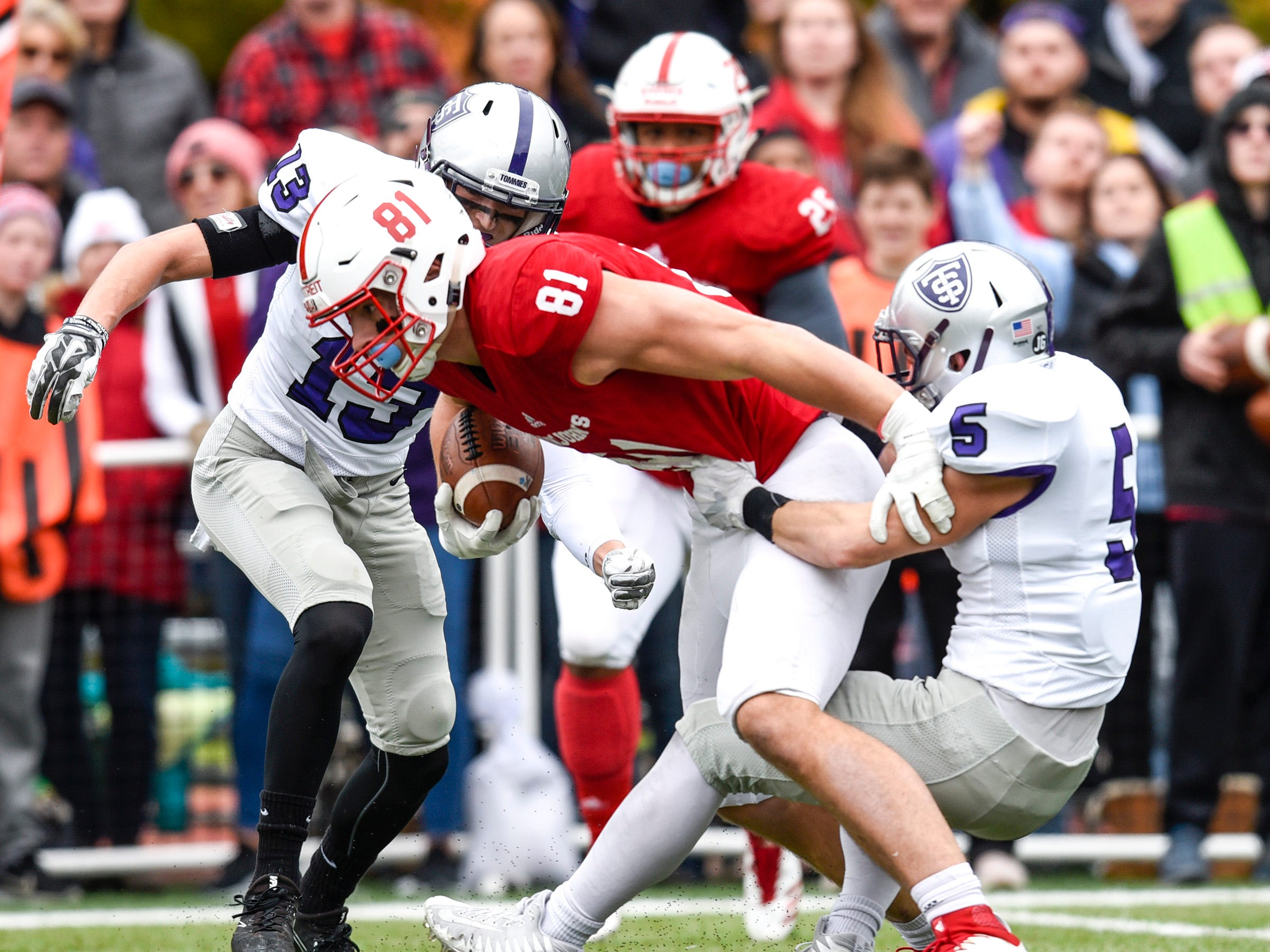 St. John's tight end Jared Streit is brought down by the St. Thomas defense during the first half Saturday, Oct. 13, in Collegeville.