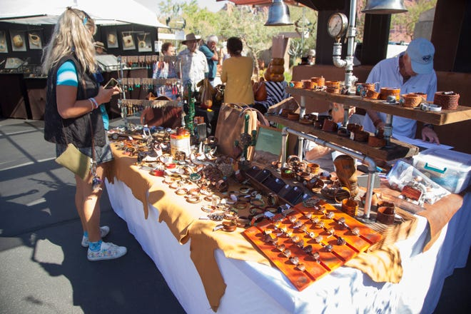 People browse various artist booths at Art in Kayenta Friday, Oct. 12, 2018.